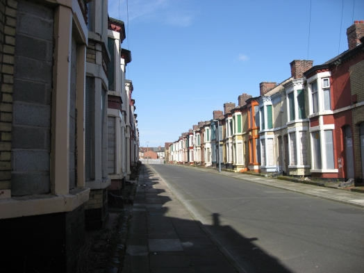 A third boarded-up street